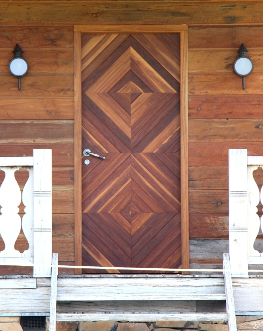 Exquisite Timber Work On The Front Door Of The Studio