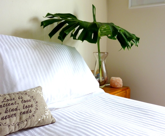 Brighter up the bedside table with some greenery.